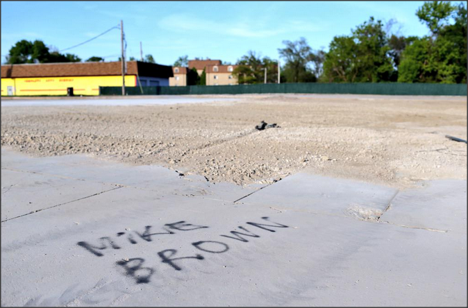 Site of the infamous West Florissant QuickTrip, now demolished, leveled and fenced off.